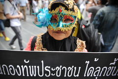 Anti-Government Protest in Bangkok. A masked protester joins an anti-government rally in Bangkok's shopping district on June 2, 2013 in Bangkok, Thailand. The Royalty Free Stock Images