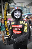 Anti-Government Protest in Bangkok. A masked royalist protester participates in a rally in Bangkok's shopping district on July 21, 2013 in Bangkok, Thailand Stock Photo