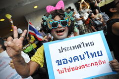 Anti-Government Protest in Bangkok. A protester in draq joins an anti-government rally in Bangkok's shopping district on June 9, 2013 in Bangkok, Thailand. The Royalty Free Stock Photo