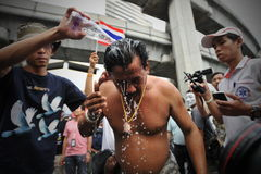 Anti-Government Protest in Bangkok. A protester washes away an unidentified tear gas like chemical after scuffles with riot police during an anti-government Stock Photography