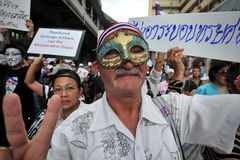 Anti-Government Protest in Bangkok. An anti-government protester wearing a mask joins a large rally in Bangkoks shopping district on June 16, 2013 in Bangkok Royalty Free Stock Photography