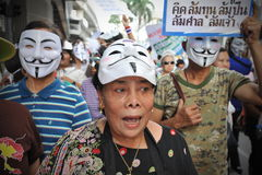 Anti-Government Protest in Bangkok. Protesters chant anti-government slogans while participating in a rally through Bangkoks shopping district on July 21, 2013 Stock Image
