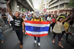 Anti-Government Protest in Bangkok. Protesters chant anti-government slogans while participating in a rally through Bangkoks shopping district on July 21, 2013 Royalty Free Stock Photo