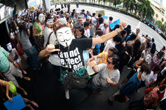 Anti-government protesters wearing Guy Fawkes masks . Royalty Free Stock Photography