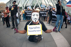 Anti-government protesters wearing Guy Fawkes masks . Stock Photos