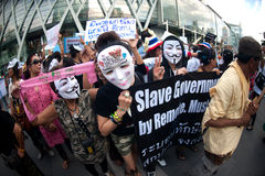 Anti-government protesters wearing Guy Fawkes masks . Royalty Free Stock Photo