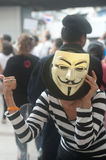 Anti-government protesters wearing Guy Fawkes masks . Stock Image