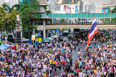 Anti-government protesting in Thailand. The anti-government protesters standing up for national anthem in at Rajprasong junction, Bangkok,  on February 8, 2014 Royalty Free Stock Photography