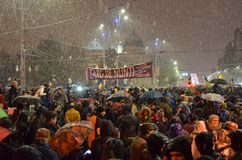 Anti government protests in Bucharest in inclement weather.
