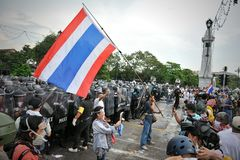 Anti-Government Rally in Bangkok. Nationalist protesters from the Pitak Siam group rally in front of a police on Makhawan Bridge on November 24, 2012 in Bangkok Stock Images