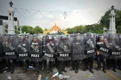 Anti-Government Rally in Bangkok. Riot police stand guard on Makhawan Bridge after coming under attack by nationalist anti-government protesters on November 24 Royalty Free Stock Images