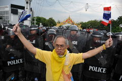 Anti-Government Rally in Bangkok. A nationalist protester from the Pitak Siam group rallies in front of riot police on Makhawan Bridge on November 24, 2012 in Royalty Free Stock Images