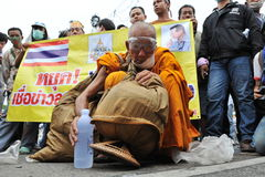 Anti-Government Rally in Bangkok. A Buddhist monk attends an anti-government rally organised by the nationalist Pitak Siam group on November 24, 2012 in Bangkok Royalty Free Stock Image