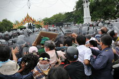 Anti-Government Rally in Bangkok. Nationalist protesters from the Pitak Siam group clash with riot police on Makhawan Bridge on November 24, 2012 in Bangkok Stock Images