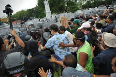 Anti-Government Rally in Bangkok. Nationalist protesters from the Pitak Siam group clash with riot police on Makhawan Bridge on November 24, 2012 in Bangkok Royalty Free Stock Image