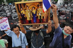 Anti-Government Rally in Bangkok. Nationalist protesters from the Pitak Siam group rally in front of riot police on Makhawan Bridge on November 24, 2012 in Stock Image