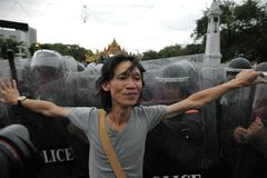 Anti-Government Rally in Bangkok. A nationalist protester from the Pitak Siam group confronts riot police on Makhawan Bridge on November 24, 2012 in Bangkok Royalty Free Stock Image