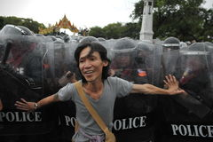 Anti-Government Rally in Bangkok. A nationalist protester from the Pitak Siam group confronts riot police on Makhawan Bridge on November 24, 2012 in Bangkok Royalty Free Stock Photo