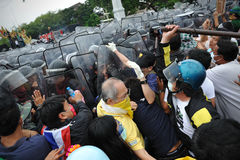 Anti-Government Rally in Bangkok. Nationalist protesters from the Pitak Siam group clash with riot police on Makhawan Bridge during a large anti-government rally Stock Photo