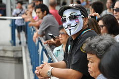 Anti-Government Rally. Onlookers watch an anti-government rally in Bangkoks shopping district on August 18, 2013 in Bangkok, Thailand. Several hundred protesters Royalty Free Stock Photo