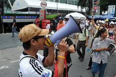 Anti-Government Rally. A protest leader directs an anti-government rally in Bangkoks shopping district on August 18, 2013 in Bangkok, Thailand. Several hundred Royalty Free Stock Image
