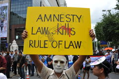 Anti-Government Rally. Protesters stage an anti-government rally in Bangkoks shopping district on August 18, 2013 in Bangkok, Thailand. Several hundred Stock Image