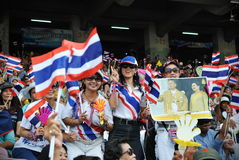 Anti-Government Rally. Supporters of the nationalist Pitak Siam group join a large peaceful anti-government rally at the Royal Turf Club on October 28, 2012 in Stock Photo