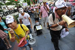 Anti-Government 'White Mask' Protest in Bangkok. Protest leaders direct an anti-government rally in Bangkok's shopping district on June 9, 2013 in Bangkok Royalty Free Stock Image