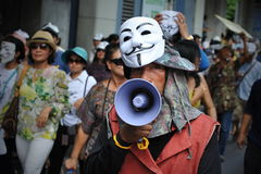 Anti-Government White Mask Protest in Bangkok. Masked protesters take part in a large anti-government rally in Bangkoks shopping district on June 30, 2013 in Stock Photos