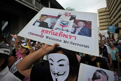 Anti-Government 'White Mask' Protest in Bangkok. An anti-government protester wearing a Guy Fawkes mask joins a large rally in Bangkok's shopping district on Stock Photography