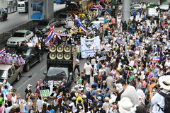 Anti-Government 'White Mask' Protest in Bangkok. Protesters wearing a Guy Fawkes masks march through Bangkok's shopping district on June 16, 2013 in Bangkok Stock Images