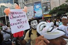 Anti-Government White Mask Protest in Bangkok. Anti-government protesters wearing Guy Fawkes masks rally in Bangkoks shopping district on June 9, 2013 in Bangkok Stock Photos