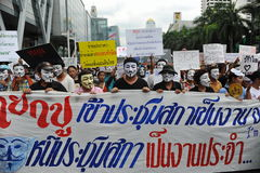 Anti-Government 'White Mask' Protest in Bangkok. Anti-government protesters wearing Guy Fawkes masks rally in Bangkok's shopping district on June 2, 2013 in Royalty Free Stock Photo
