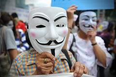 Anti-Government 'White Mask' Protest in Bangkok. Anti-government protesters wearing Guy Fawkes masks rally in Bangkok's shopping district on June 2, 2013 in Stock Image