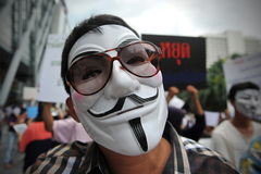 Anti-Government 'White Mask' Protest in Bangkok. Anti-government protesters wearing Guy Fawkes masks rally in Bangkok's shopping district on June 2, 2013 in Royalty Free Stock Photography