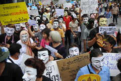 Anti-Government 'White Mask' Protest in Bangkok. Anti-government protesters wearing Guy Fawkes masks rally in Bangkok's shopping district on June 2, 2013 in Royalty Free Stock Images