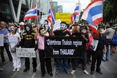 Anti-Government 'White Mask' Protest in Bangkok. Anti-government protesters wearing Guy Fawkes masks rally in Bangkok's shopping district on June 2, 2013 in Stock Photo