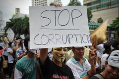 Anti-Government 'White Mask' Protest in Bangkok. Anti-government protesters wearing Guy Fawkes masks rally in Bangkok's shopping district on June 2, 2013 in Royalty Free Stock Image