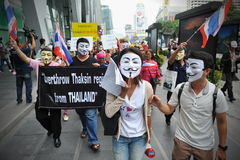 Anti-Government 'White Mask' Protest in Bangkok. Anti-government protesters wearing Guy Fawkes masks rally in Bangkok's shopping district on June 2, 2013 in Stock Images