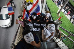 Anti-Government 'White Mask' Protest in Bangkok. Anti-government protesters wearing Guy Fawkes masks rally in Bangkok's shopping district on June 2, 2013 in Stock Photography