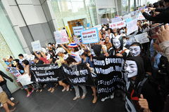 Anti-Government 'White Mask' Protest in Bangkok. Anti-government protesters wearing Guy Fawkes masks rally in Bangkok's shopping district on June 9, 2013 in Stock Photo