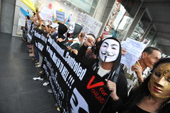 Anti-Government 'White Mask' Protest in Bangkok. Anti-government protesters wearing Guy Fawkes masks rally in Bangkok's shopping district on June 9, 2013 in Stock Photography