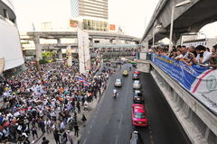 Anti-Government 'White Mask' Protest in Bangkok. Anti-government protesters wearing Guy Fawkes masks rally in Bangkok's shopping district on June 9, 2013 in Stock Images