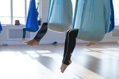 Anti-gravity yoga. People doing anti-gravity  yoga  in hammock. indoor fitness club. break relax Stock Images