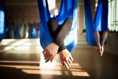 Anti-gravity yoga. People doing anti-gravity  yoga  in hammock. indoor fitness club. break relax. shot from above Stock Image