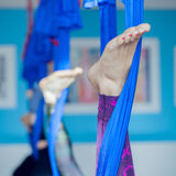 Anti-gravity yoga. People doing anti-gravity  yoga  in hammock. indoor fitness club. break relax. shot from above Royalty Free Stock Photos
