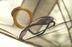 Anti insect bracelet and sunglasses. In a tent Stock Photography