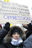 Anti-Israel occupation of Gaza Rally. TORONTO - JANUARY 10: A teenage Arab girl holding a banner of a famous quote from John Locke, during a rally to condemn Stock Photography