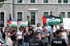 Anti-Israel rally in Ottawa. People gather to protest Israel after the recent attack of the Gaza flotilla, and Ottawa's stand regarding Israel.  Ottawa Stock Image