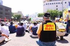 anti japan kärn- protester Arkivfoto
